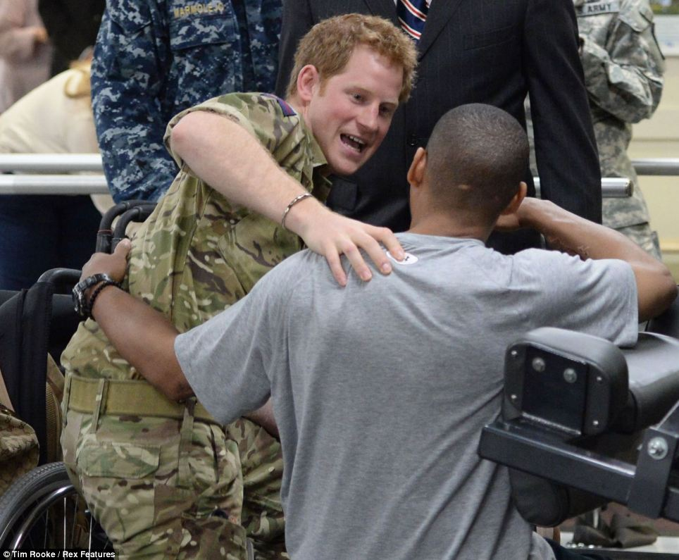 Making friends: The 28-year-old prince, who has just returned from Afghanistan, seemed at ease as he chatted with the servicemen at the medical center