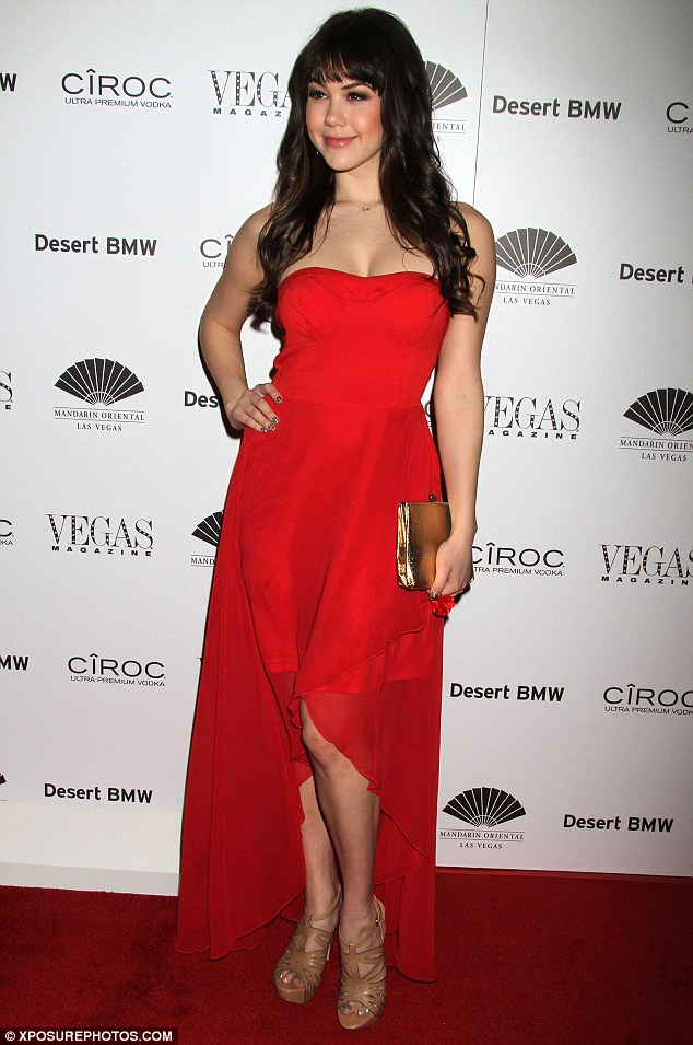 Lady in red: Miss Playboy Claire Sinclair slipped into a red strapless dress for the occasion