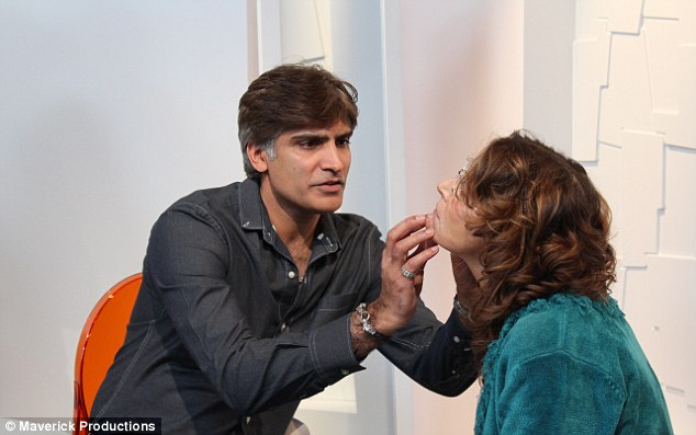 'I could feel the lumps straight away': Mr Vik Vijh at the Last Chance Salon examined Jo to see if there was anything he could do to help