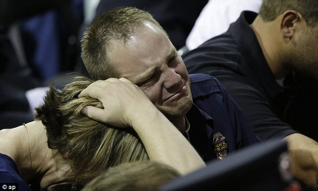 Public grief: At last month's public memorial for the 12 people killed responding to the fire, Bryce Reed (pictured) gave a heartfelt and often humorous eulogy for his close friend Cyrus Reed (not related)