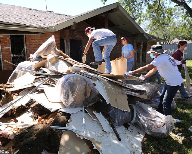 Clearup: Students clean debris at a home in West, Texas, that was damaged due to the explosion. The blast caused tens of millions of dollars in damage to the surrounding area