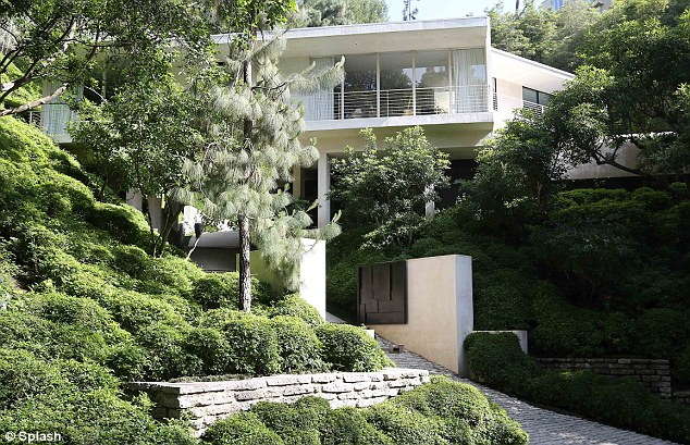 On the hunt: Kim and Kanye were reportedly taking a tour through this home in the hills