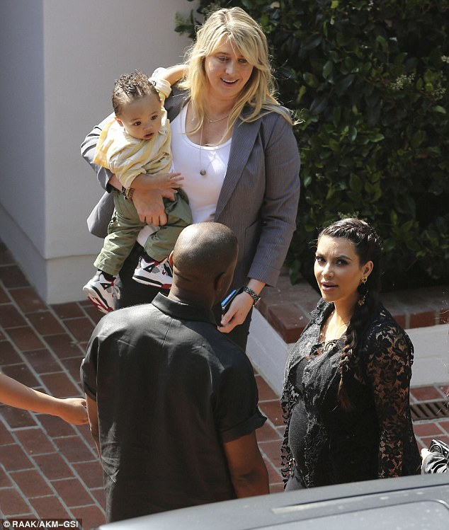 Friends: Kim and Kanye were joined by a woman who was holding a baby