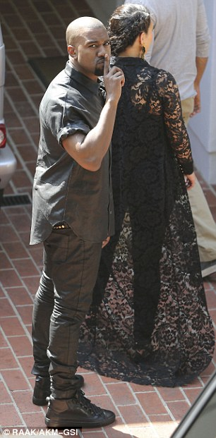 Kim Hand-in-hand: The couple viewed the property hand-in-hand