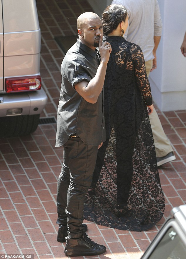 Sorry Kanye, the secret is out! Kim was joined by her boyfriend Kanye West, who was trying to hush the paps as they descended on the property