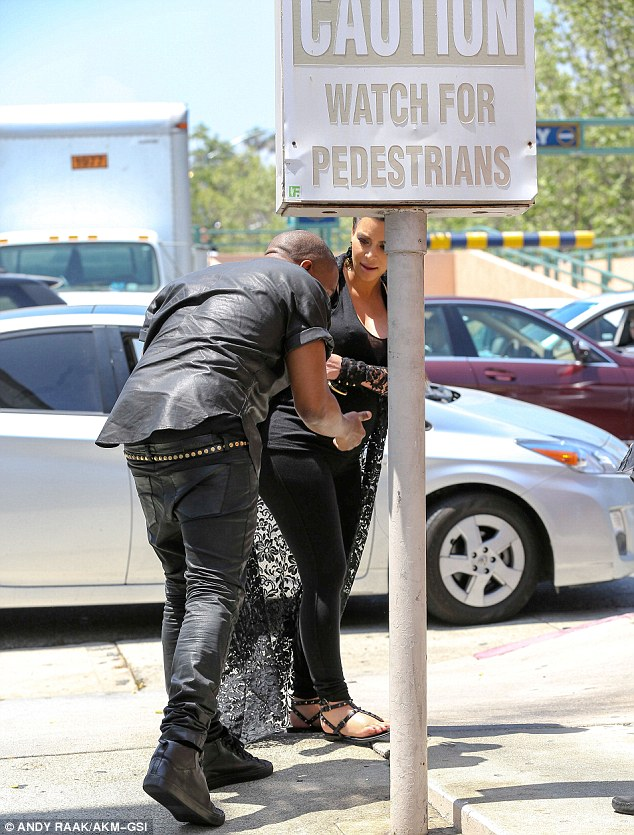 Watch where you are going! Later in the day Kanye took Kim out for lunch and hit his head on a signpost as they made their way to the eatery