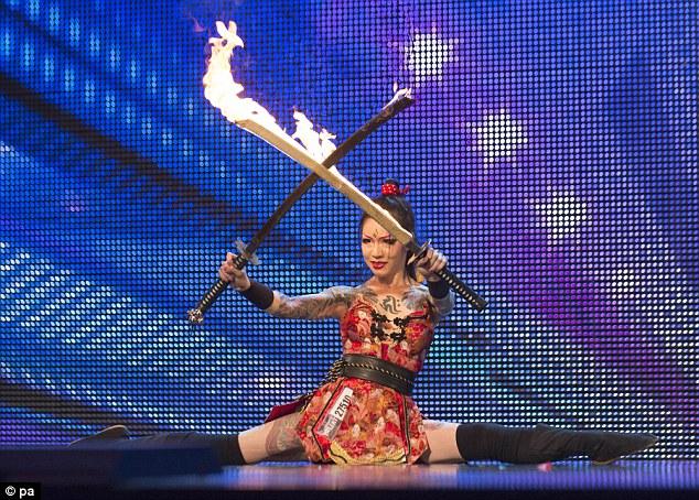 Saucy: Tattooed circus performer Yusura Circus is said to moonlight at notorious fetish nightclub Torture Garden