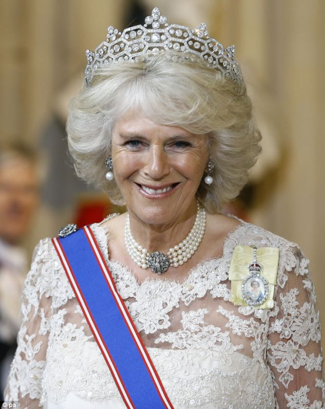 On sparkling form: The Duchess of Cornwall in a tiara lent by the Queen for this week's State Opening of Parliament