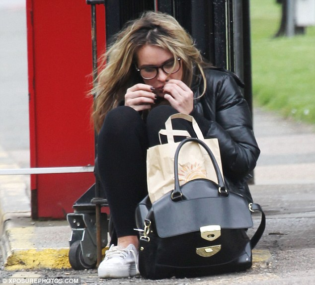 Everything ok? Kierston Wareing was spotted sitting on the side of the road after she finished work on Friday