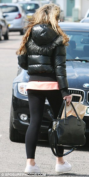 Laid back: Kierston dressed down with leggings and a padded jacket, while she wore white trainers