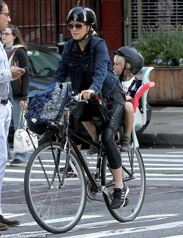Green-minded: Naomi Watts was seen biking her lookalike son Alexander to school on Friday in Manhattan