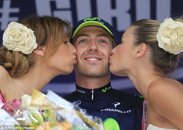 Delights: Brit Alex Dowsett gets a couple of celebratory kisses after winning stage 8 of the Giro
