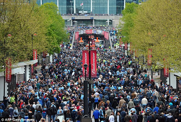 The famous walk: City and Wigan fans make their way down Wembley Way to the stadium