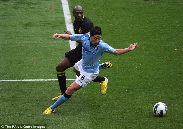 Closely watched: Samir Nasri, who was substituted in the second half, tries to get away from Boyce