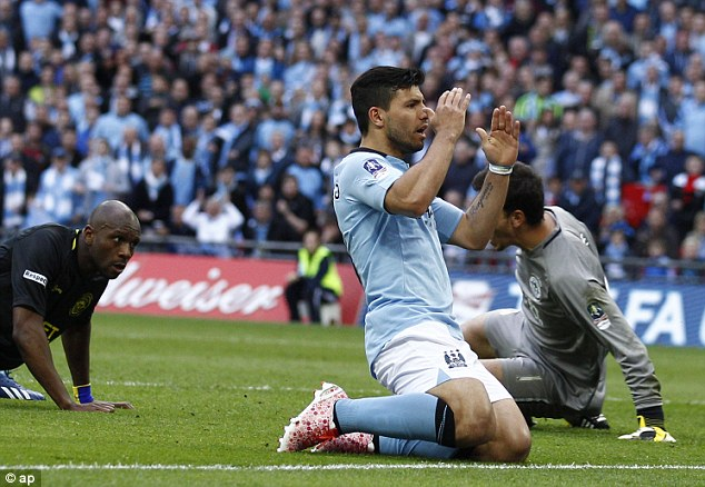 Head in hands: Sergio Aguero reacts to a missed chance for Manchester City