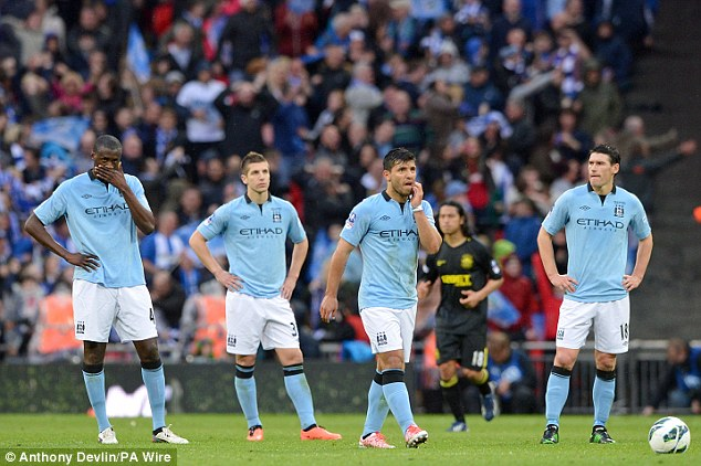 Beaten stars: City players look despondent after their shock defeat in the FA Cup final