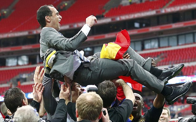 Uplifting: Wigan manager Roberto Martinez is thrown in the air by his players