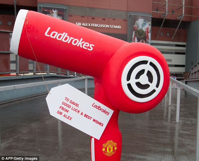 Welcoming gift: A giant hairdryer for David Moyes