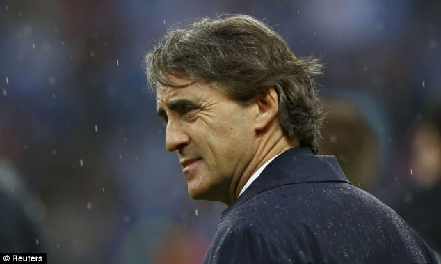 In or out? Mancini rubbishes speculation of him leaving City after the shock defeat to Wigan