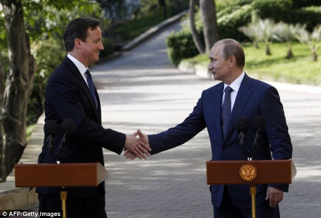 Hand of friendship: David Cameron, left, shakes hands with Vladimir Putin, right, before the start of a joint press conference after a meeting at the Bocharov Ruchei state residence in Sochi