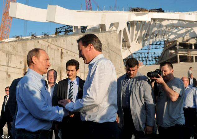 Sporting handshake: Mr Putin, left, and Mr Cameron speak while visiting the Fisht Olympic Stadium where the opening and closing Ceremonies of the 2014 Winter Olympics will be held