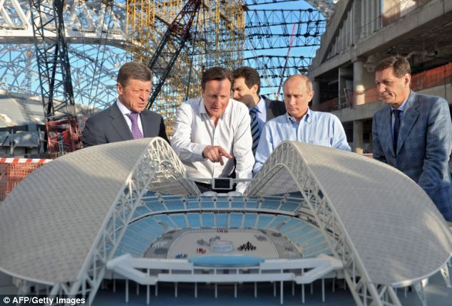 View from above: The leaders check out a model of a stadium during a visit to the future Olympic park in Sochi