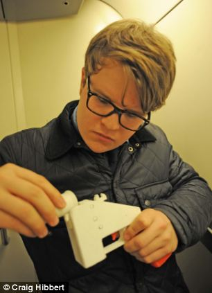 Reporter Simon Murphy puts the 3D gun together in the Eurostar toilet