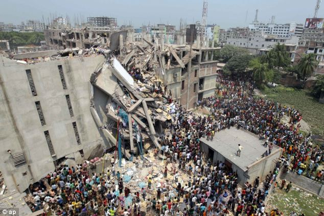 Tragedy: At least 1,100 people died when the garment factory in Savar, near Dhaka in Bangladesh collapsed