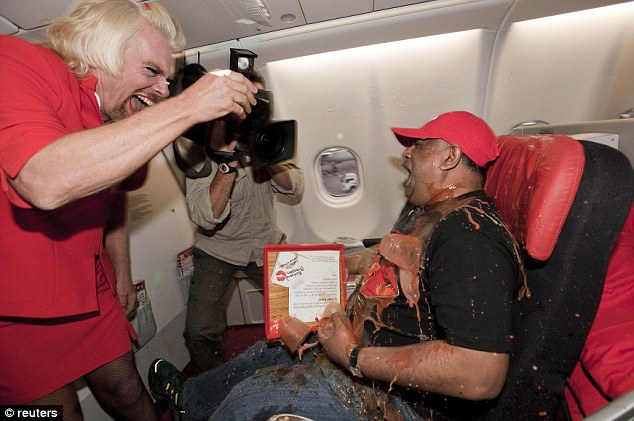 Cheeky: Branson then went on to pour the drinks all over Fernandes, who didn't have a change of trousers
