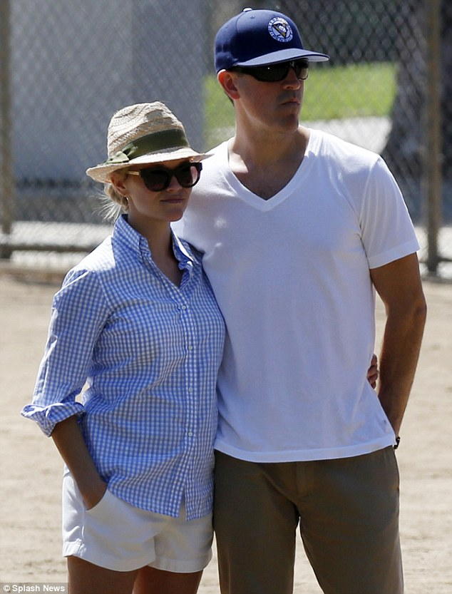 Sticking together: Reese and Jim stand on the sidelines, sticking together through the recent scandal