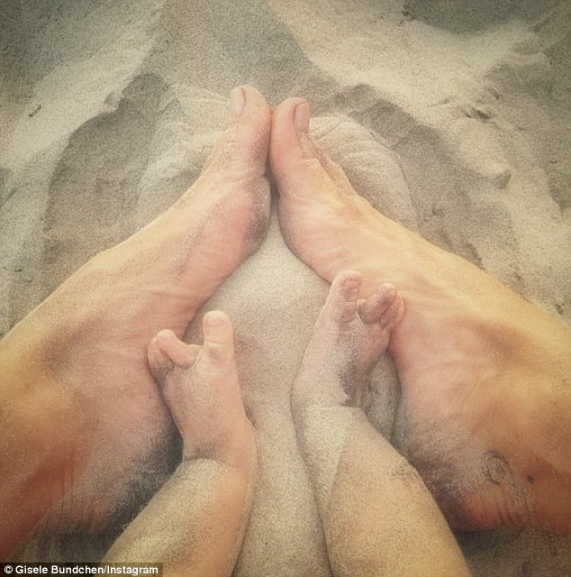 Sentimental: Gisele Bündchen released a shot of her own feet beside five-month-old daughter Vivian Lake's