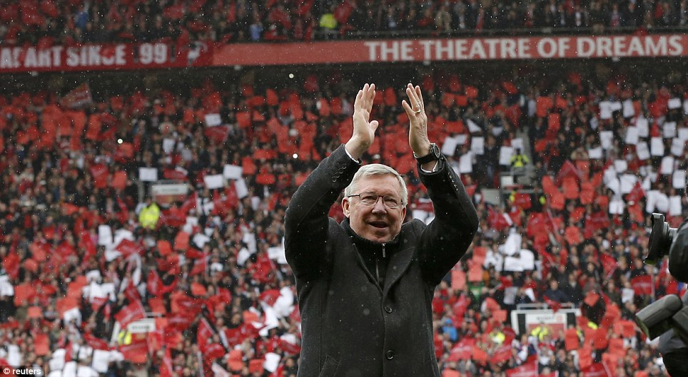 Applause: Ferguson claps his baying audience as he came onto the pitch to cheers from the home crowd