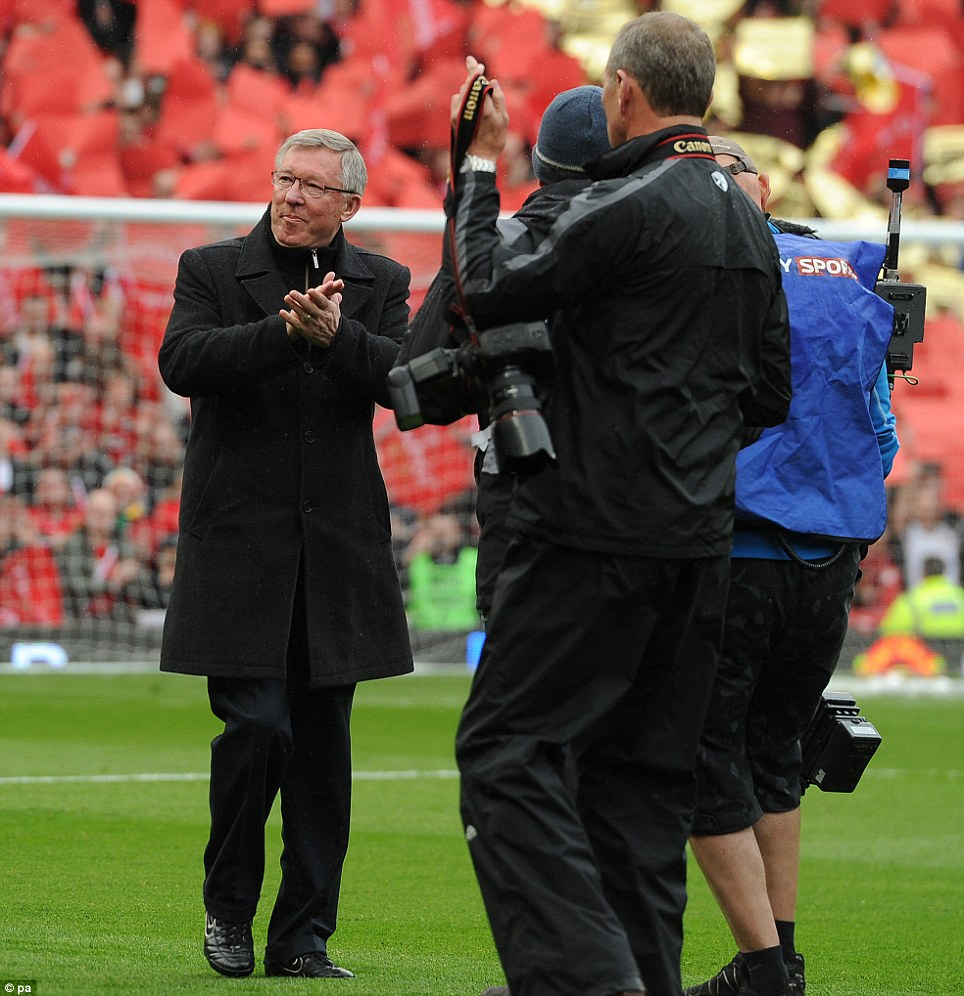 Party atmosphere: Ferguson applauded the Manchester United fans as he made his way onto the pitch to manage his final home game at the club