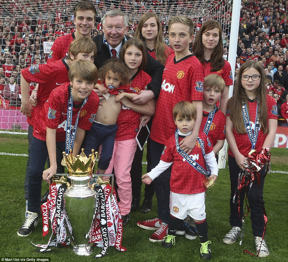 Legacy: Sir Alex Ferguson was joined on the pitch by his 11 grandchildren following his final victory at Old Trafford