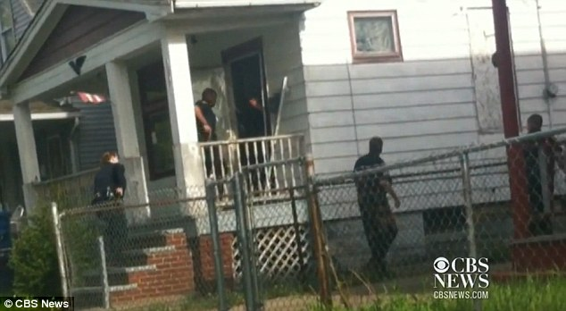 Intense: The video captures police officers prying the door of Ariel Castro's home, and flooding in, some reaching for their guns