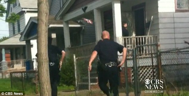 Response: Additional officers sprint to the home after gaining entry through the front door
