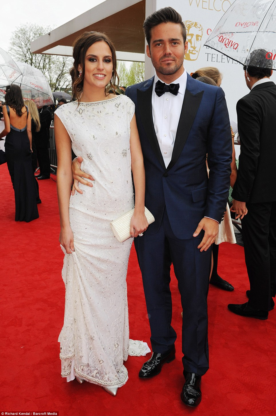 Classy act: Made in Chelsea's Lucy Watson, here with current boyfriend Spencer Matthews, looked beautiful in her full length dress