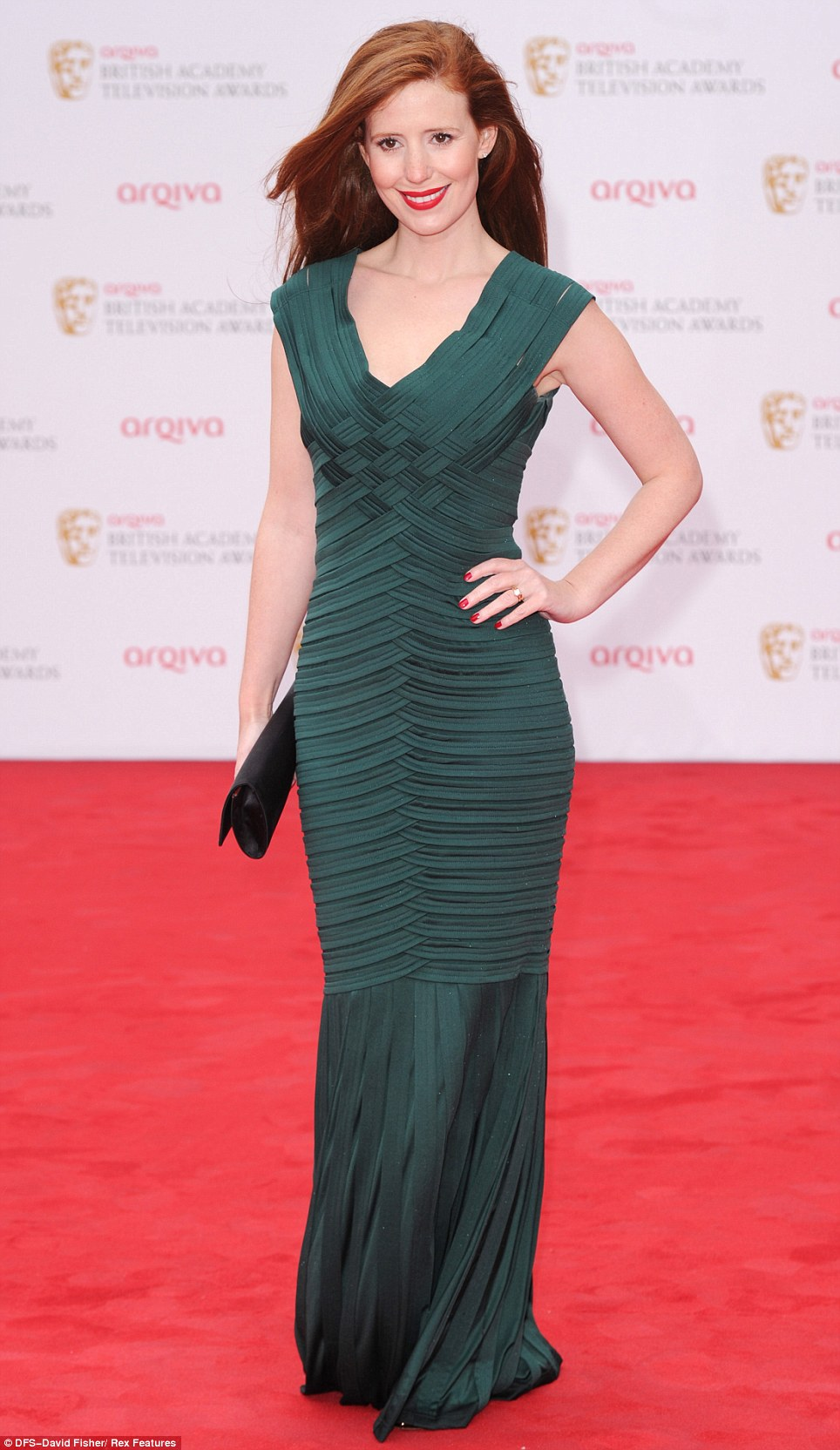 Enviable figure: Actress Amy Nuttal showed off her impressive body in a tight green outfit