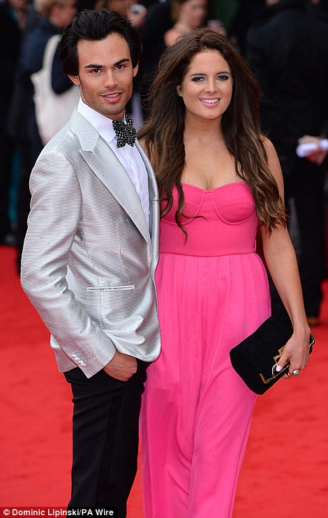 Friends and co-star: Binky was joined on the red carpet by Mark-Francis (left) who helped her down the red carpet, and shared gossip outside the venue with Lucy Watson and Louise Thompson