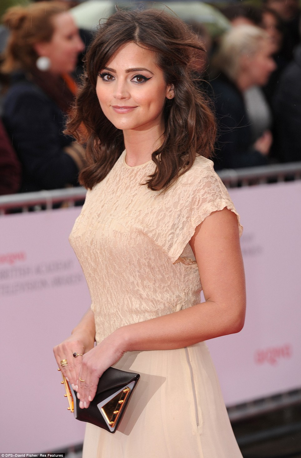Who's that girl: Dr Who star Jenna-Louise Coleman looked cute in a nude coloured dress as she attended the TV BAFTAs