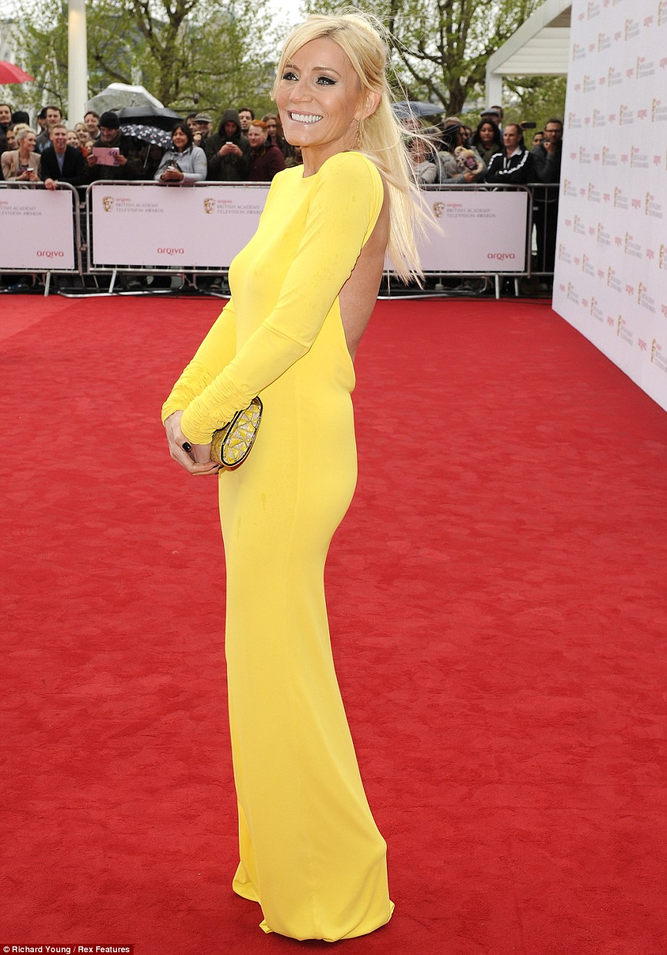 All bright: Coronation Street star Michelle Collins chose a canary yellow coloured full length dress to attend the star studded event