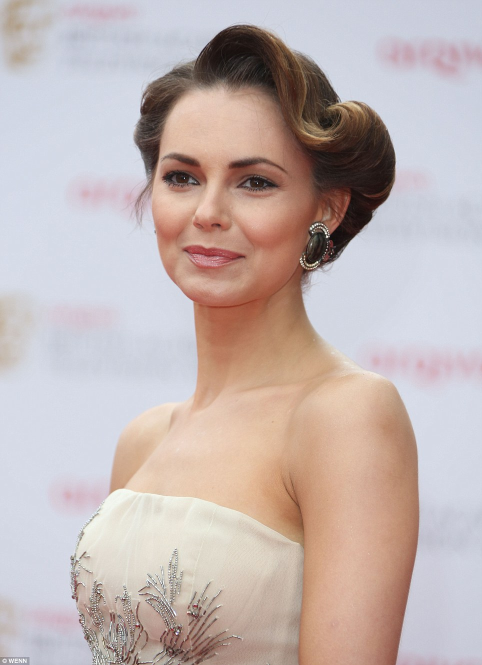 Screen beauty: Former Eastenders actress Kara Tointon looked stunning in a strapless dress with classic movie-star hair