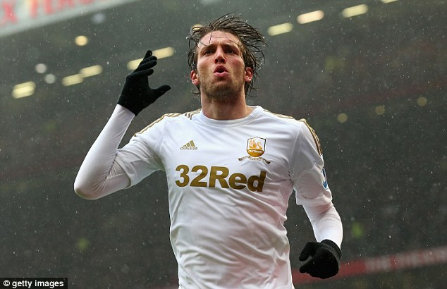 Partners in crime: Michu is likely to stay with Laudrup as they plan their voyage in Europe next season