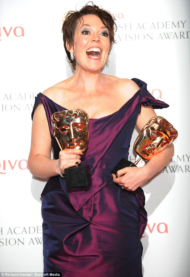 Someone's happy! Olivia Colman became the woman of the night at Sunday's TV Baftas as she picked up two trophies for her roles in Accused and Twenty Twelve