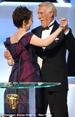 In shock: Sir Bruce Forsyth handed her one of the awards and even treated her to some of his moves as they stood together on stage
