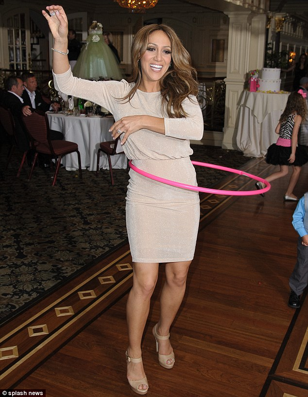 Any excuse will do: Melissa used the occasion as an opportunity to show off her skills with a hula hoop