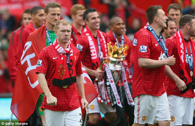 Great of the game: Paul Scholes (left) retires from football at the end of the season