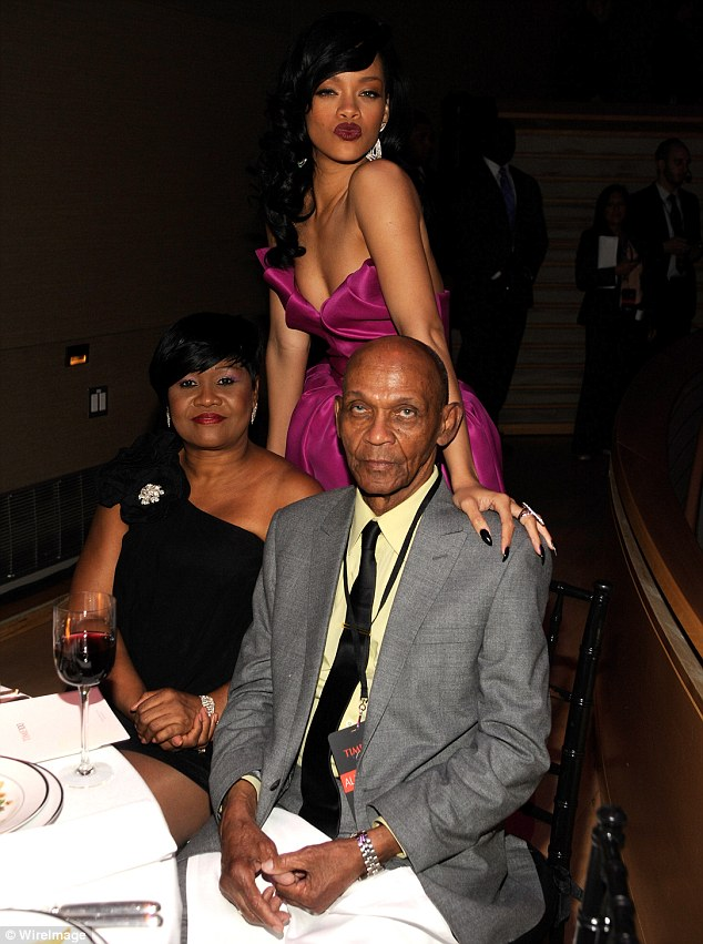 Don't mess with Monica: Rihanna, pictured with Monica and grandfather Lionel in 2012, has confessed that her mother is the one person in the world she truly fears