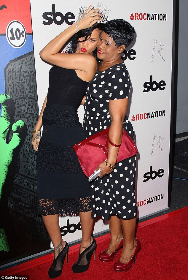 Mother-daughter bond: 'Her attitude Rihanna, she got it from her mama!!! Happy Mother's Day beautiful!! What a lucky little b***h I am to have come from you!' Rihanna said of her mother, with whom she is pictured in October