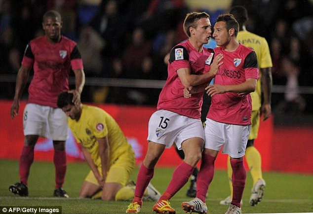 Little magician: Cazorla (right) joined Arsenal after dazzling at Malaga - as did Nacho Monreal